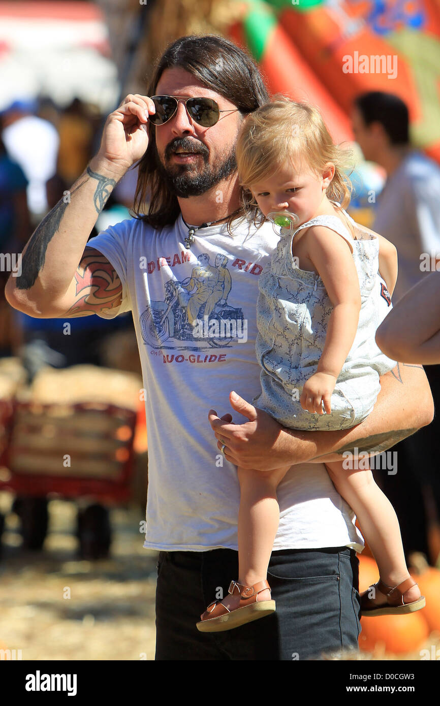 Foo Fighters and Them Crooked Vultures rocker, Dave Grohl, with his daughter Harper Willow, enjoying family day - Stock Image