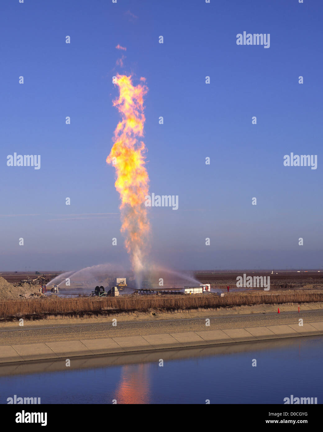 Water Cannons Reign In a Massive Natural Gas Well Fire - Stock Image