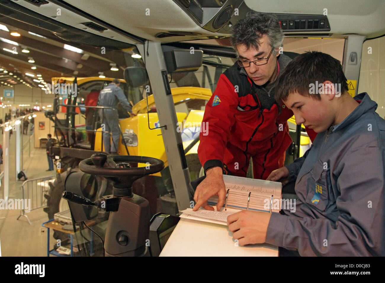 TEACHER AND STUDENT ON A FARMING MECHANICS TEST 42ND OLYMPIADES DES METIERS IN BRITTANY RENNES FRANCE - Stock Image