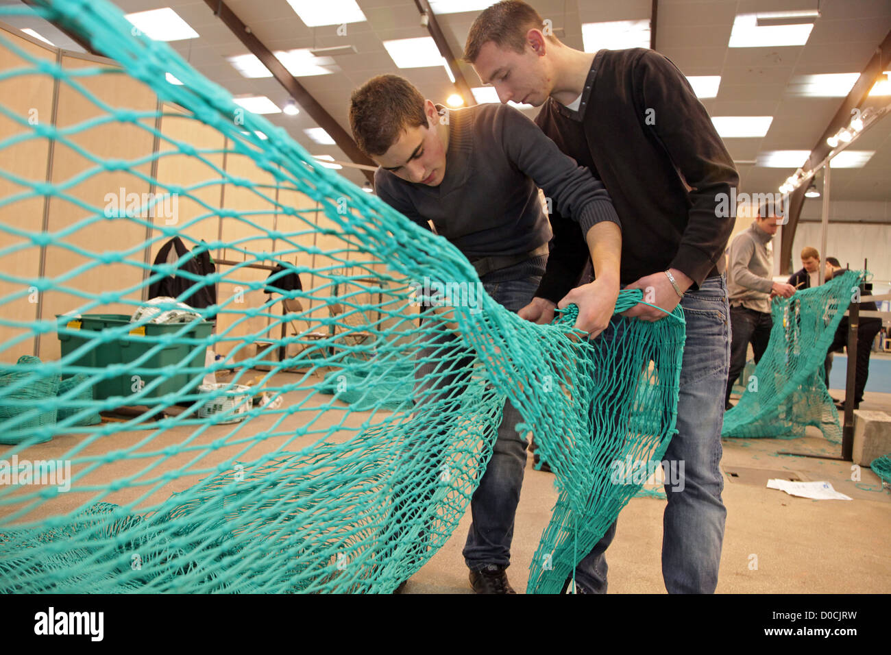 STUDENT IN TRAWL NET MAKING SEA PROFESSIONS 42ND OLYMPIADES DES METIERS IN BRITTANY RENNES FRANCE - Stock Image