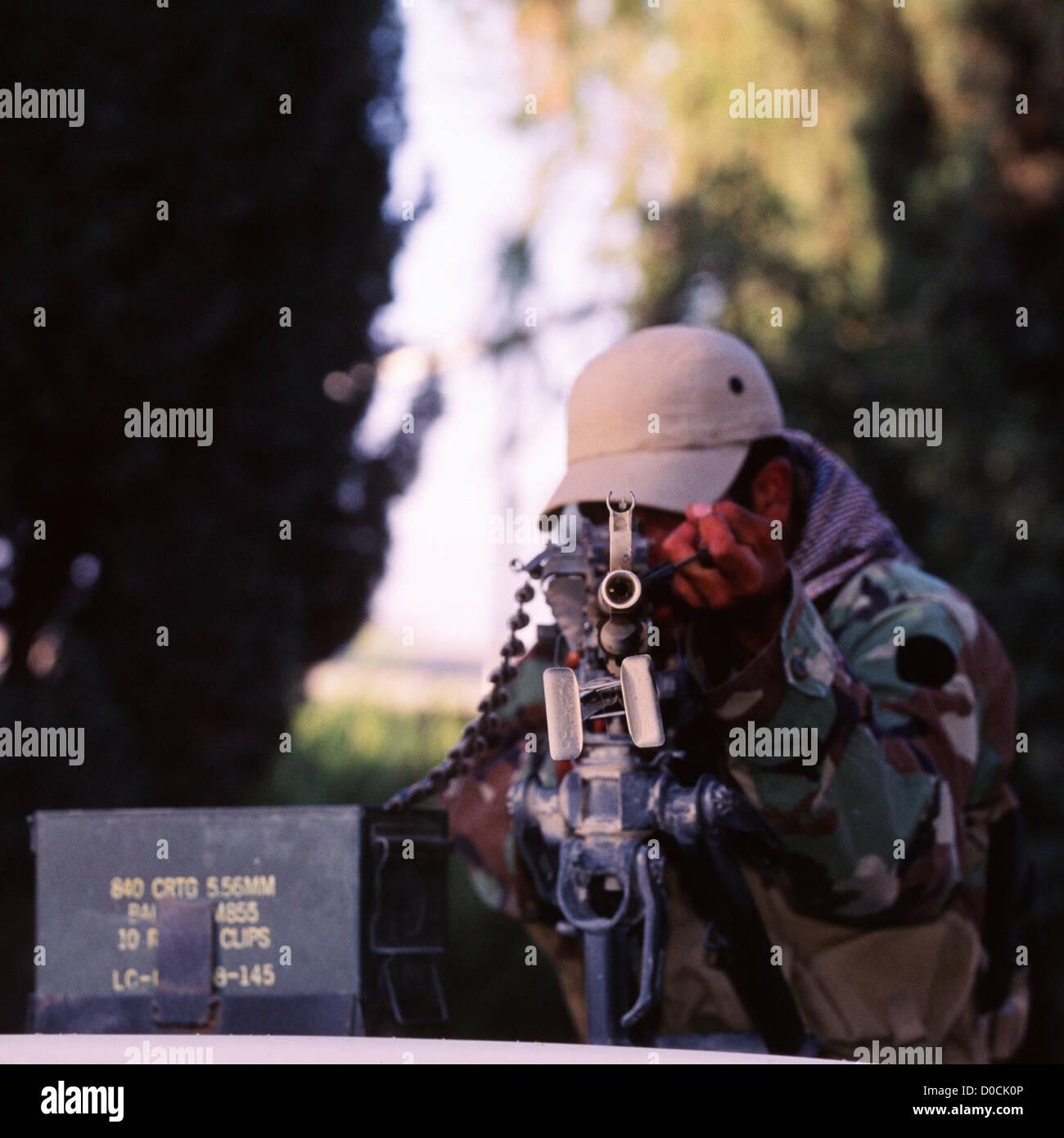 An Afghan Commando Aims a PK Light Machine Gun - Stock Image