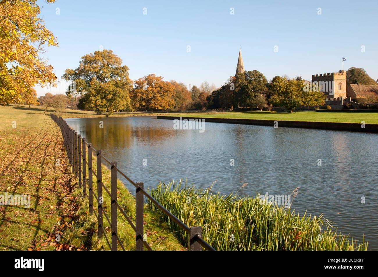 Broughton Castle moat, Oxfordshire, UK - Stock Image