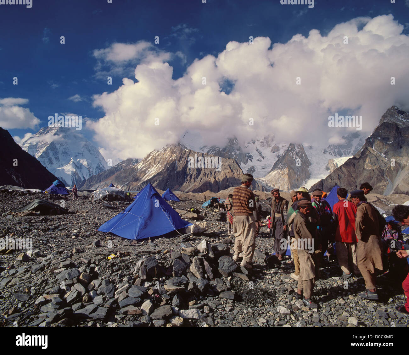 The Bustle of Balti Porters Below K2 - Stock Image