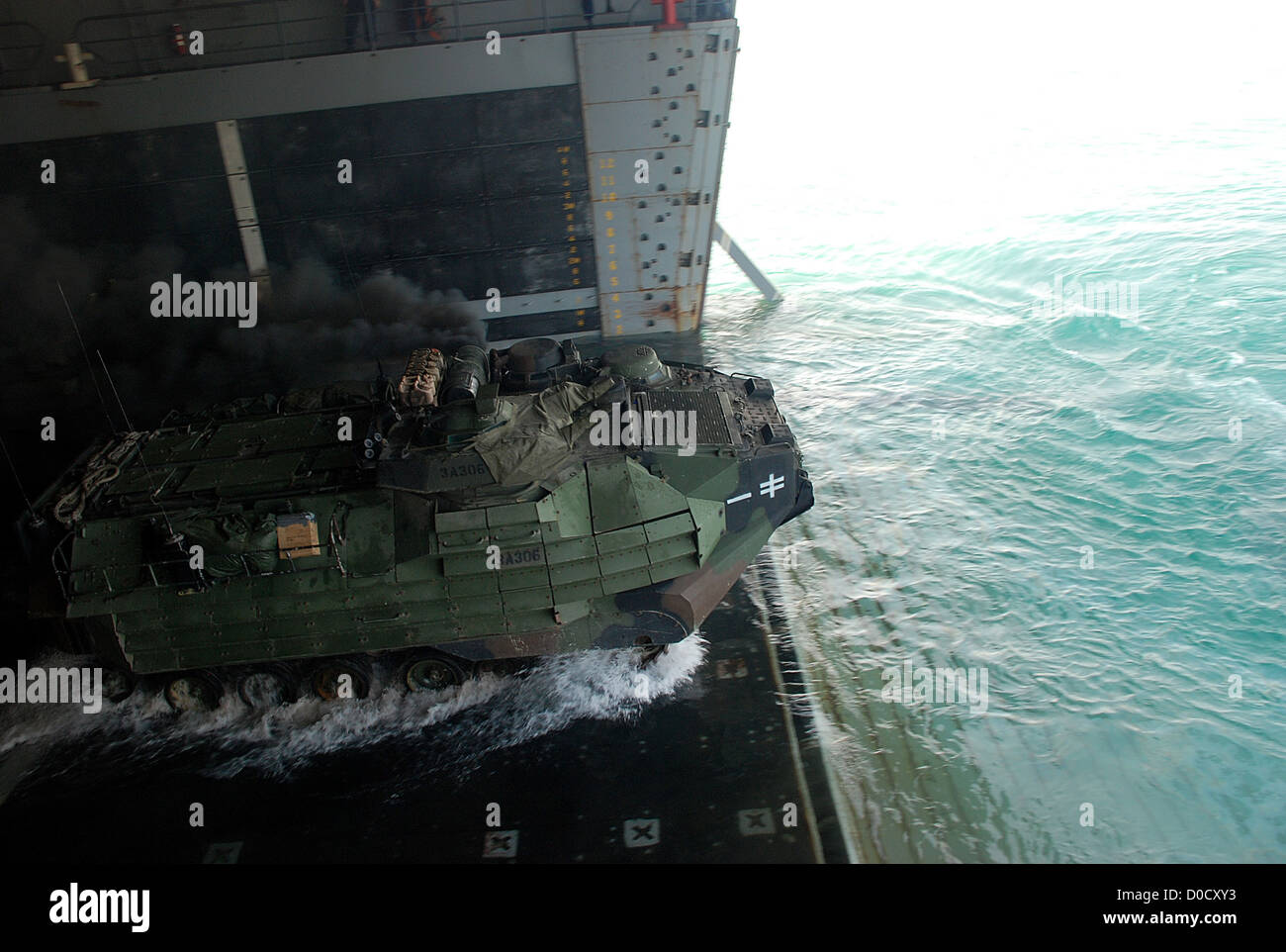 An amphibious assault vehicle (AAV) departs the amphibious transport dock ship USS Green Bay (LPD 20) during a routine Stock Photo