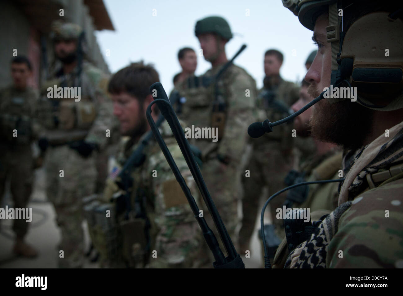 Coalition force members conduct a mission brief before conducting a movement to visit Afghan National Security Force - Stock Image