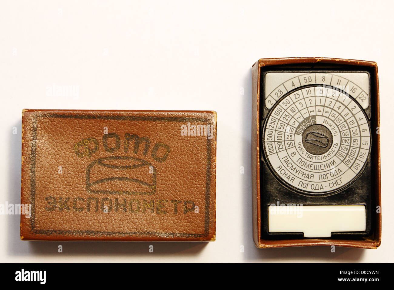 Old photographic exposure meter from USSR in case - Stock Image
