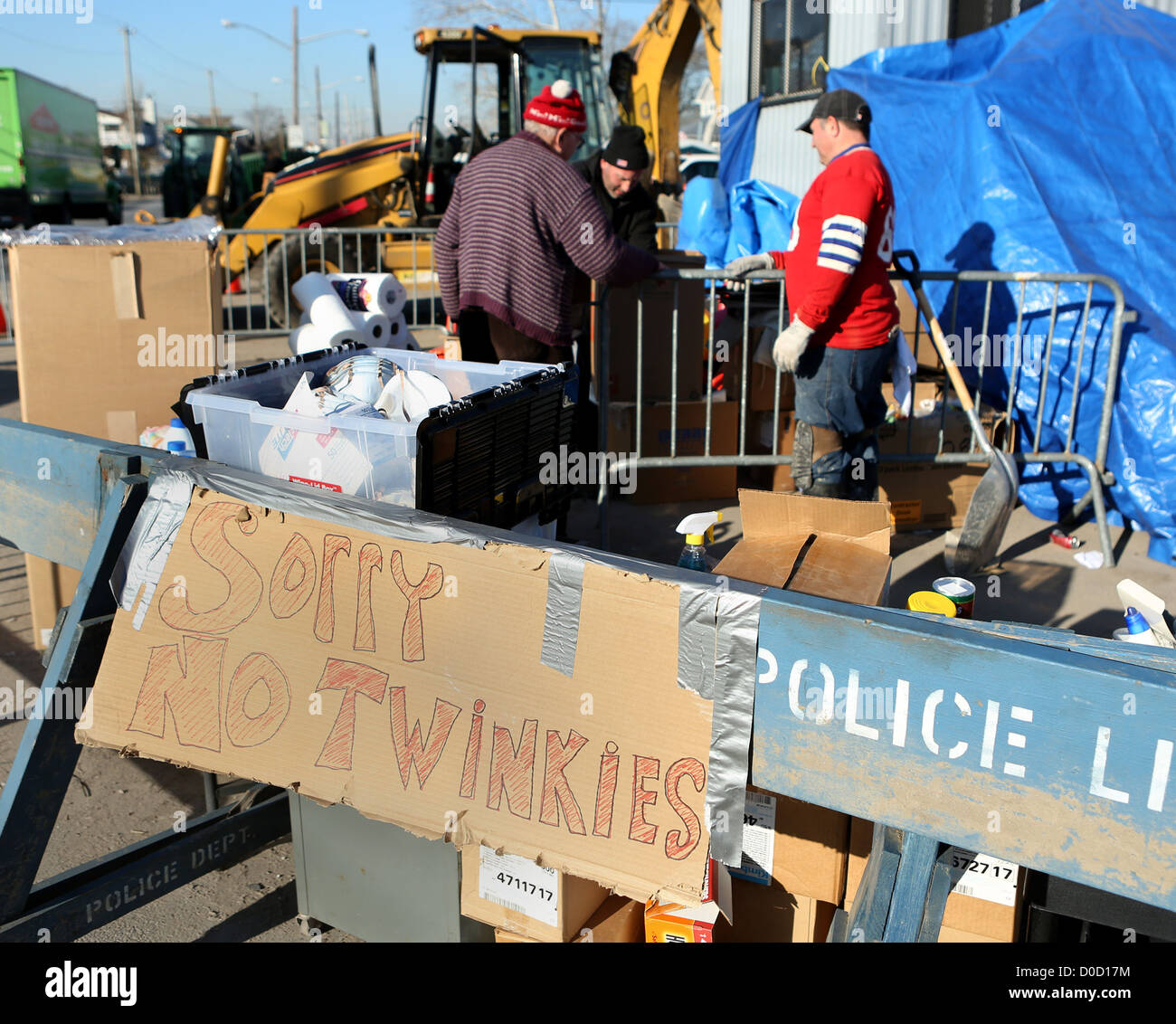 Volunteers hand out cleaning supplies to clean up after Tropical Storm Sandy damaged Breezy Point, NY, November - Stock Image