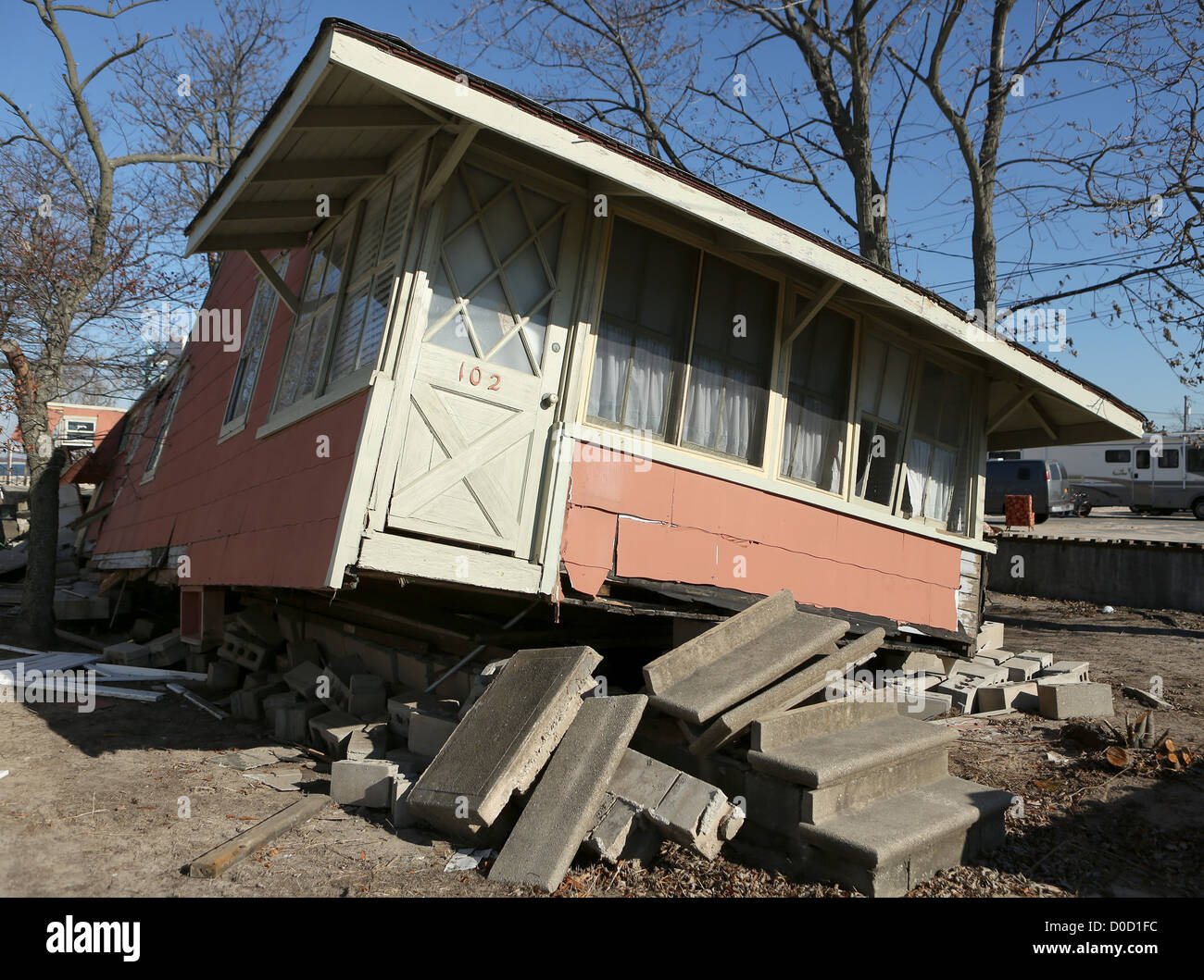 A Breezy Point, New York hous knocked off its base by Tropical Storm Sandy awaits repair or destruction, November - Stock Image