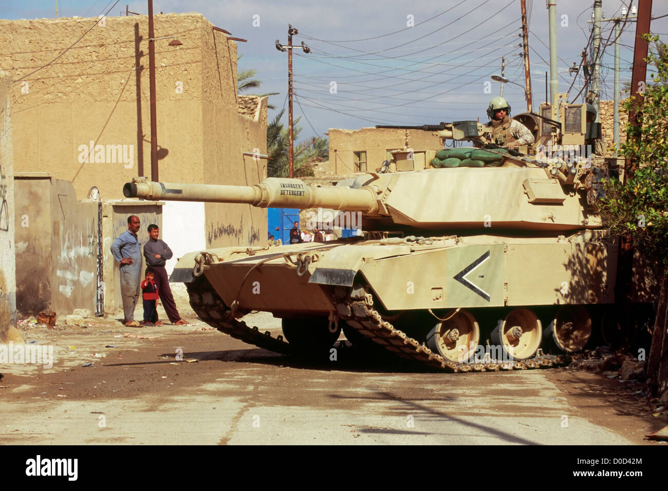 Locals Gaze at a Passing Marine Corps Tank During a Combat Operation in Haqlaniyah, Iraq - Stock Image