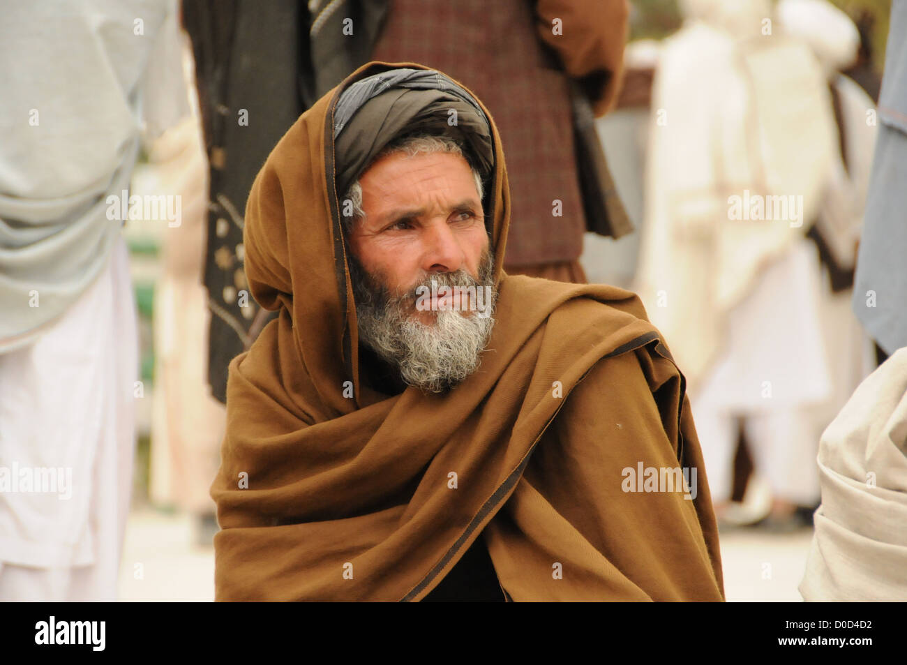 An Afghan man waits to meet with government officials at the provincial governor's compound in Farah City, Nov. - Stock Image