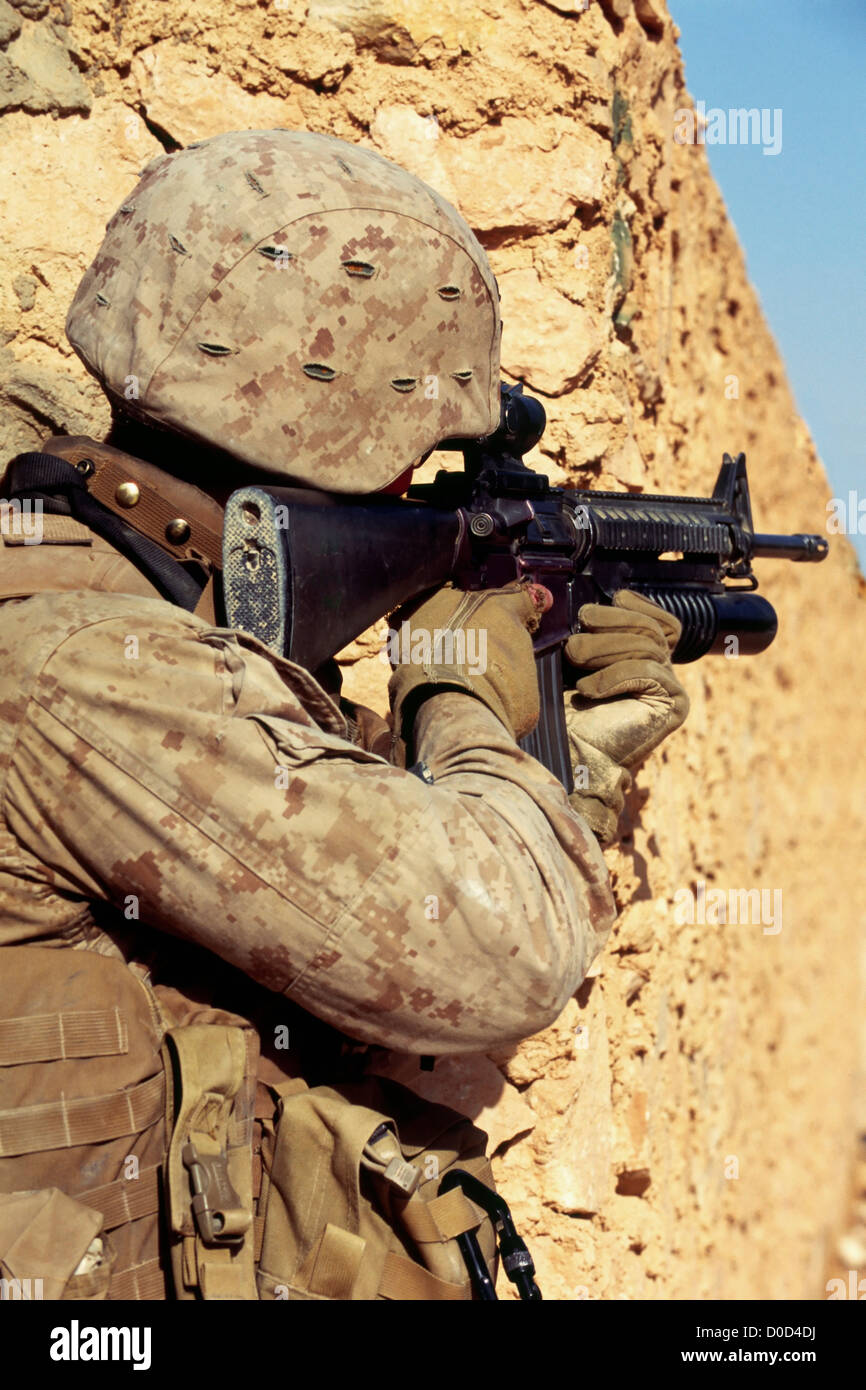 A US Marine Scans Distance Scope His M-16 During Combat Operation in City Haditha in Iraq's Anbar Province - Stock Image