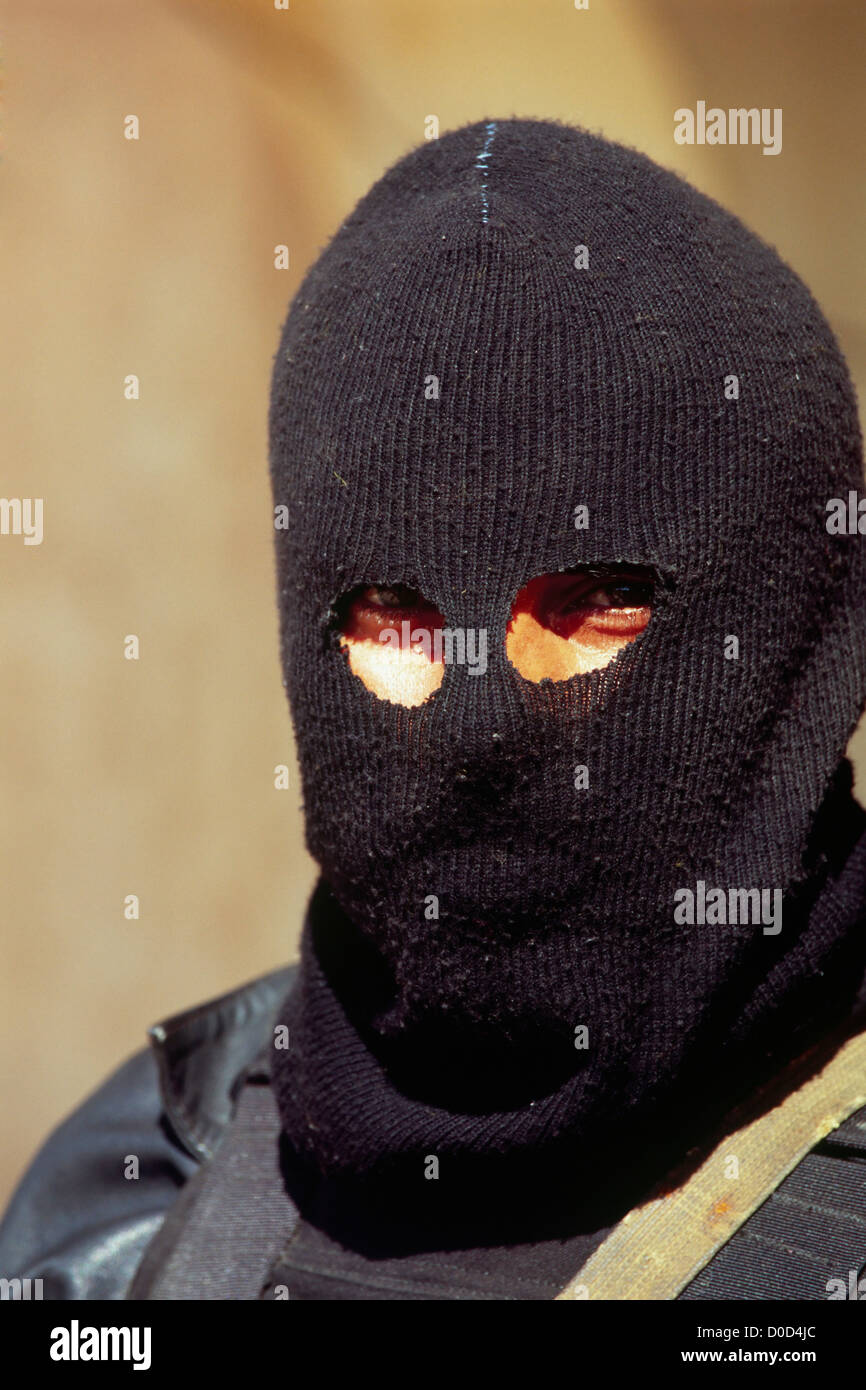 A Masked Member of the Iraqi National Police Near the City of Haditha, Iraq - Stock Image