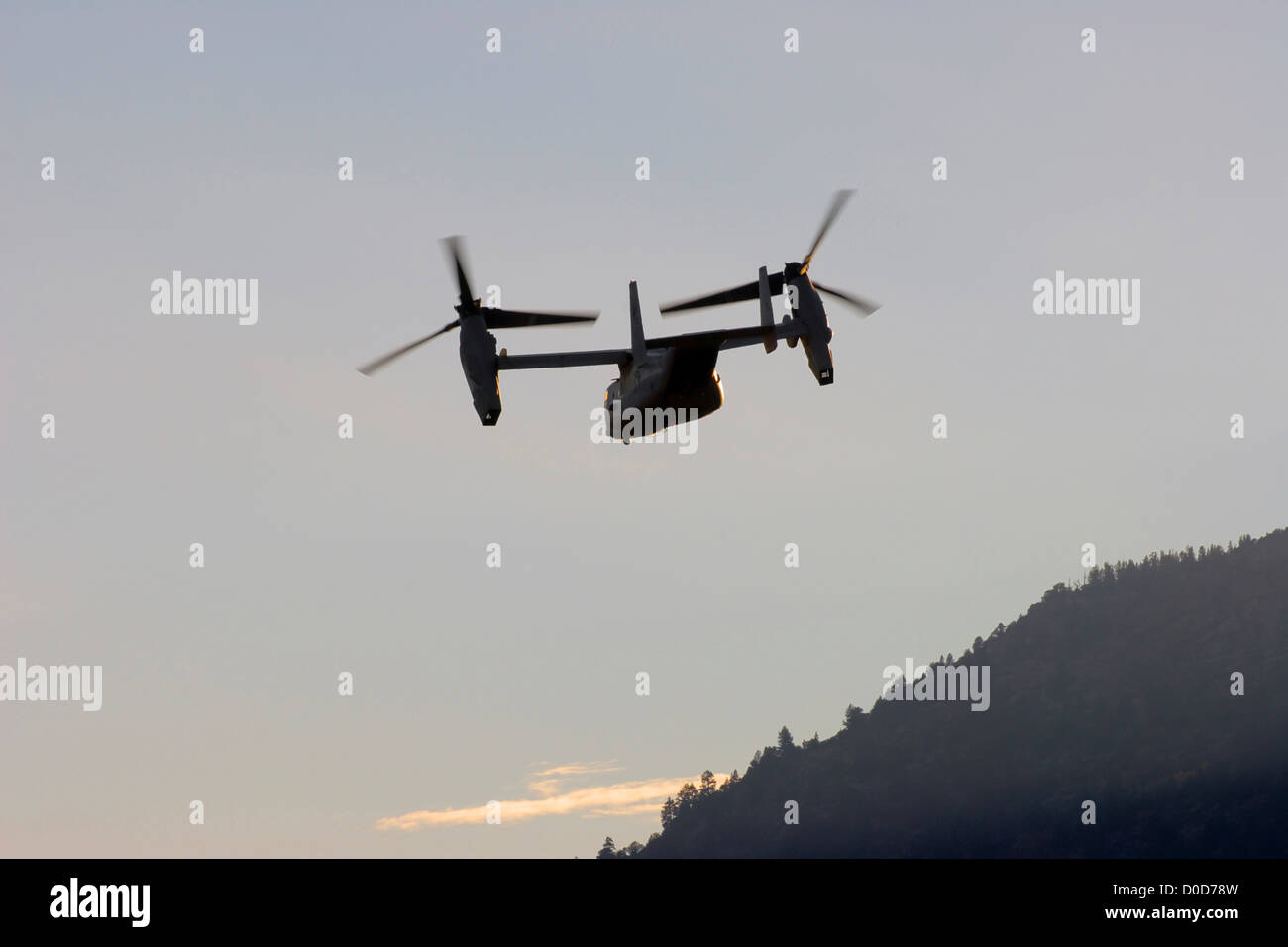 The V-22 Rotates its Nacelles From Helicopter Mode to Airplane Mode After Launching - Stock Image