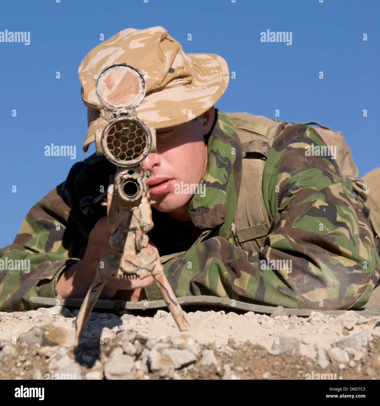 A British Royal Marine Commando Sniper Takes Aim - Stock Image
