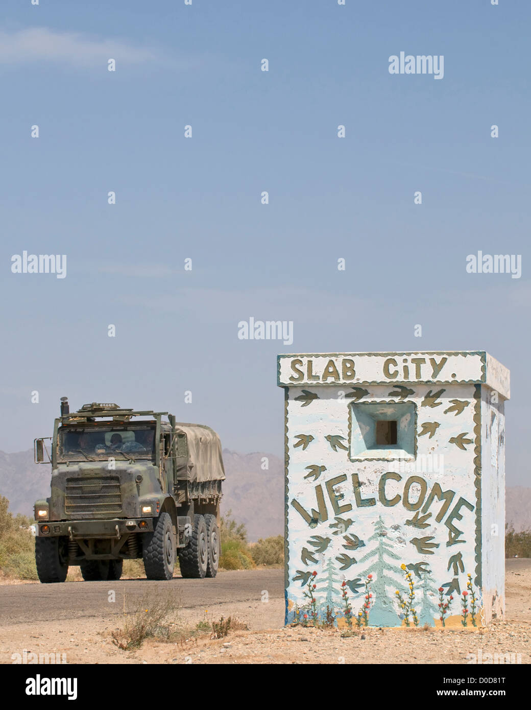 Military Transport Vehicle at Entrance to Slab City - Stock Image