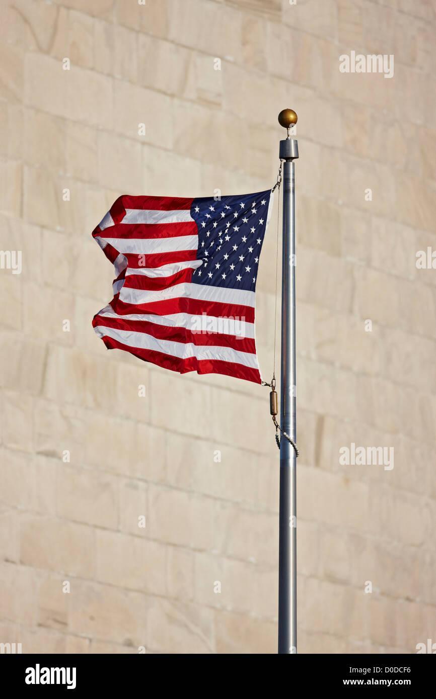 c787da19fcd6 American Flag Set Against the Washington Monument - Stock Image