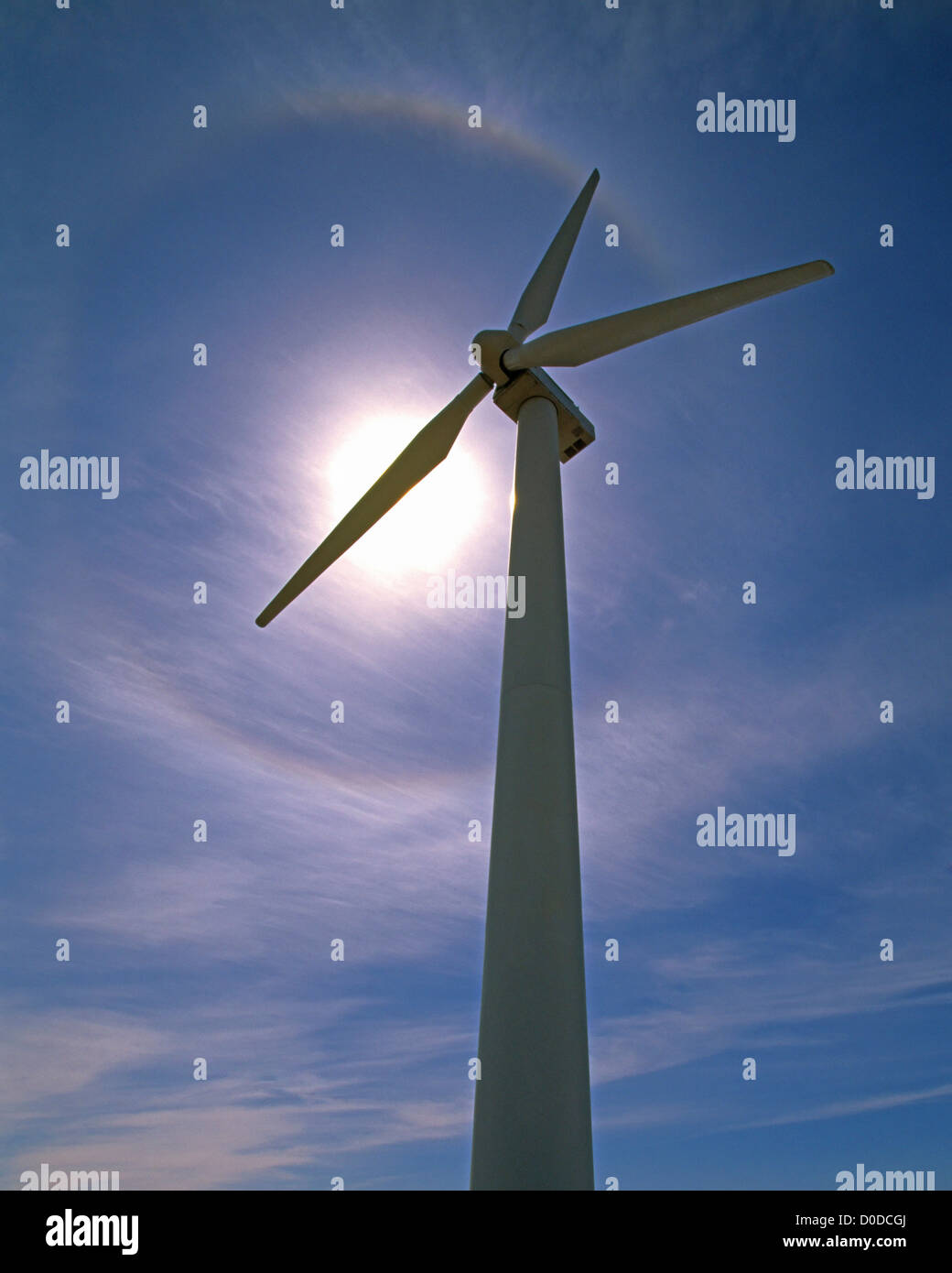 A Layer of Cirrostratus Forms a Halo Above a Wind Turbine - Stock Image