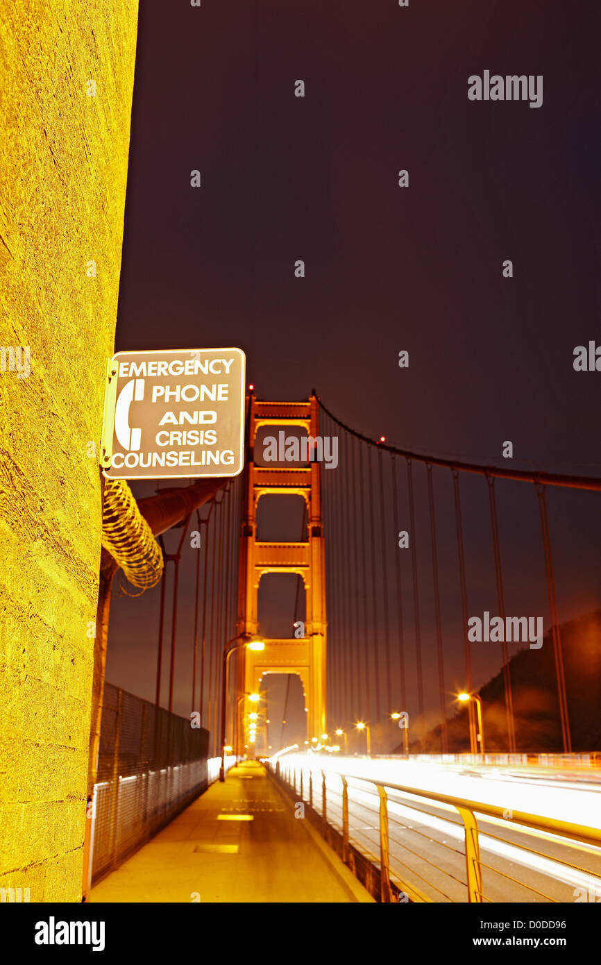 A suicide prevention sign greets passers-by on the sidewalk on the north side of the Golden Gate Bridge - Stock Image