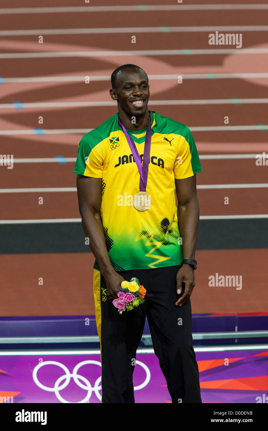 Usain Bolt JAM With His Gold Medal For Winning Mens 200m Final At The Olympic Summer Games London 2012