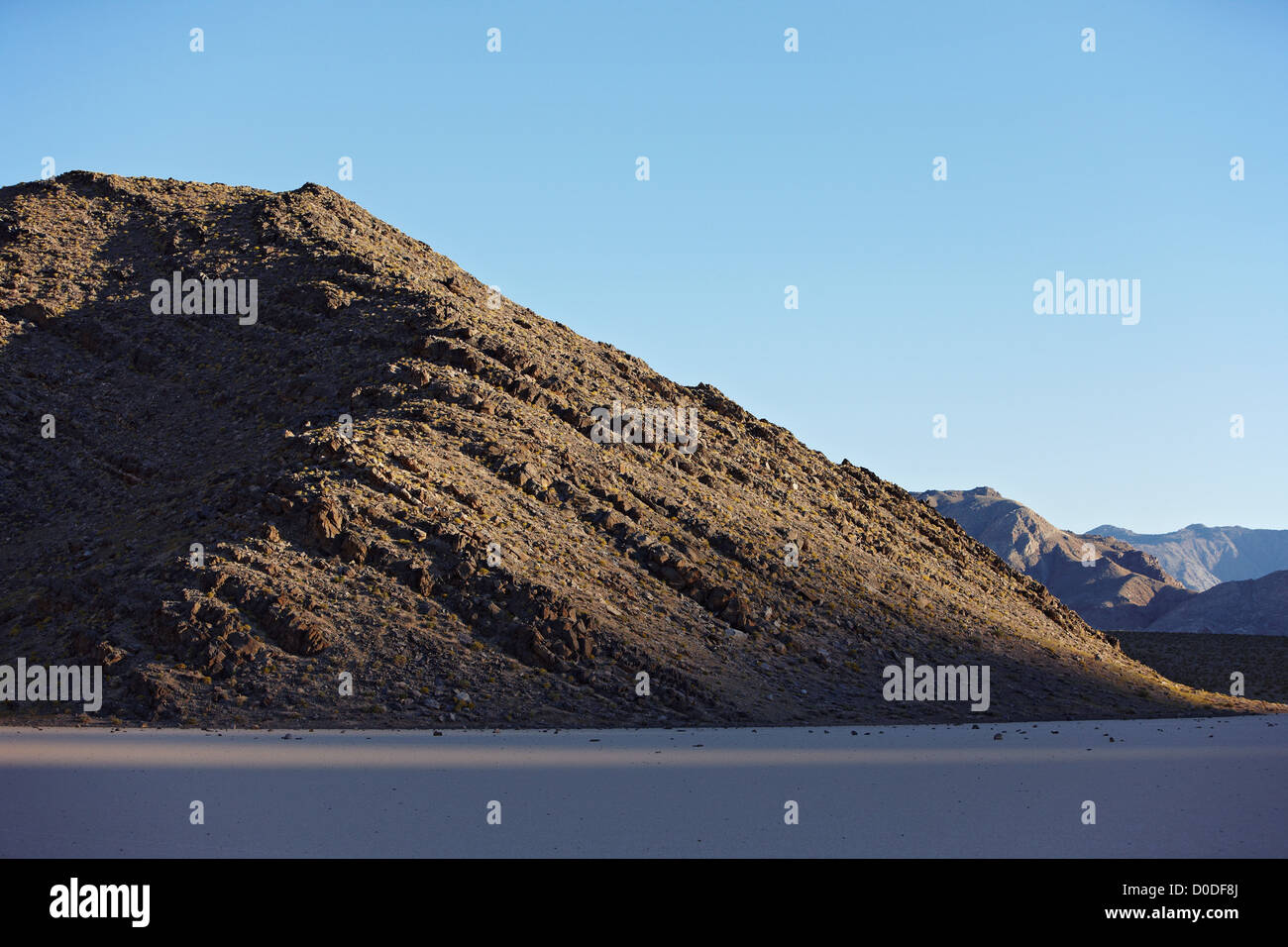A ridge dolomite that forms southern periphery Racetrack Valley abuts Racetrack Playa Death Valley National Park - Stock Image