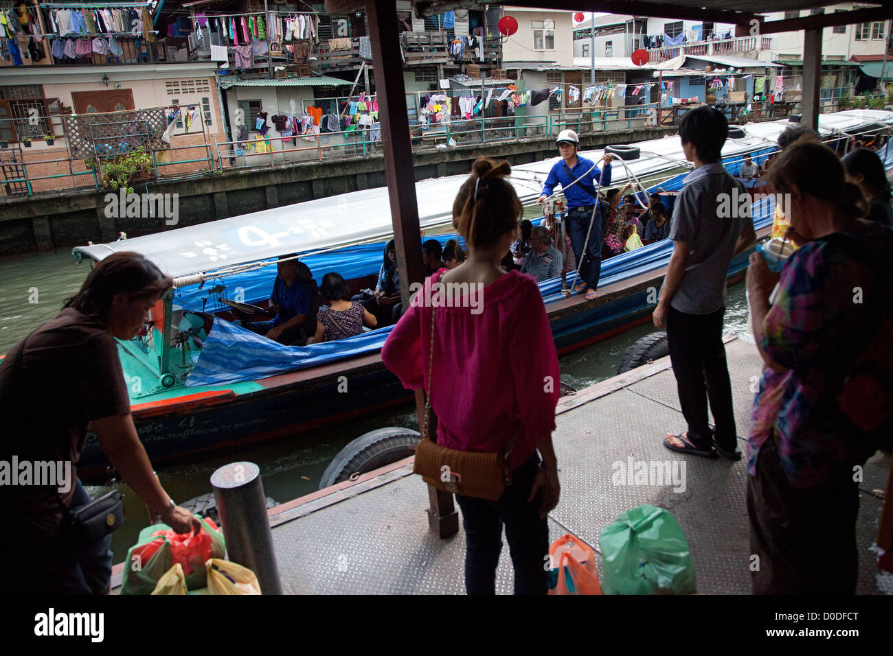 TAXI BOATS OR RIVER BUSSES ON A CANAL LINKED TO THE CHAO PHRAYA RIVER PUBLIC TRANSPORT IN THE CITY OF BANGKOK BANGKOK - Stock Image