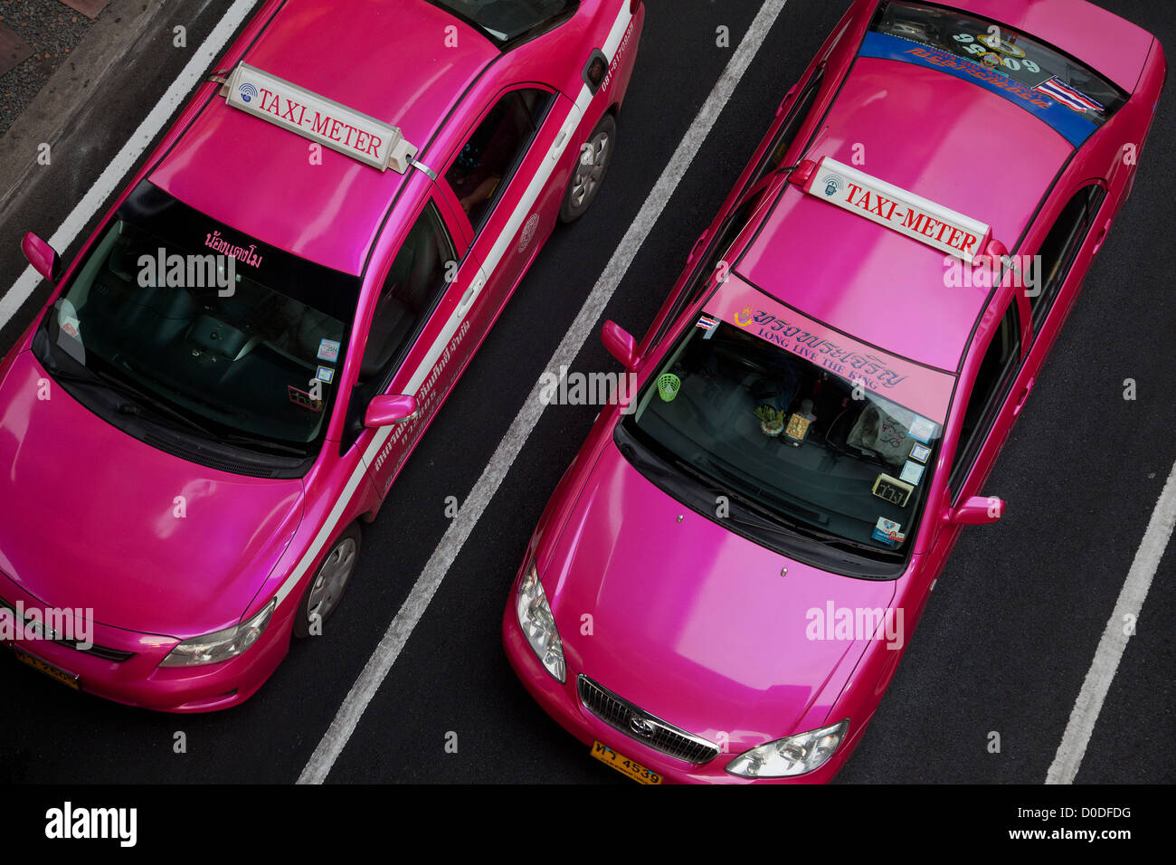 METER TAXIS THE CITY'S OFFICIAL PINK TAXIS EQUIPPED WITH A METER BANGKOK THAILAND - Stock Image