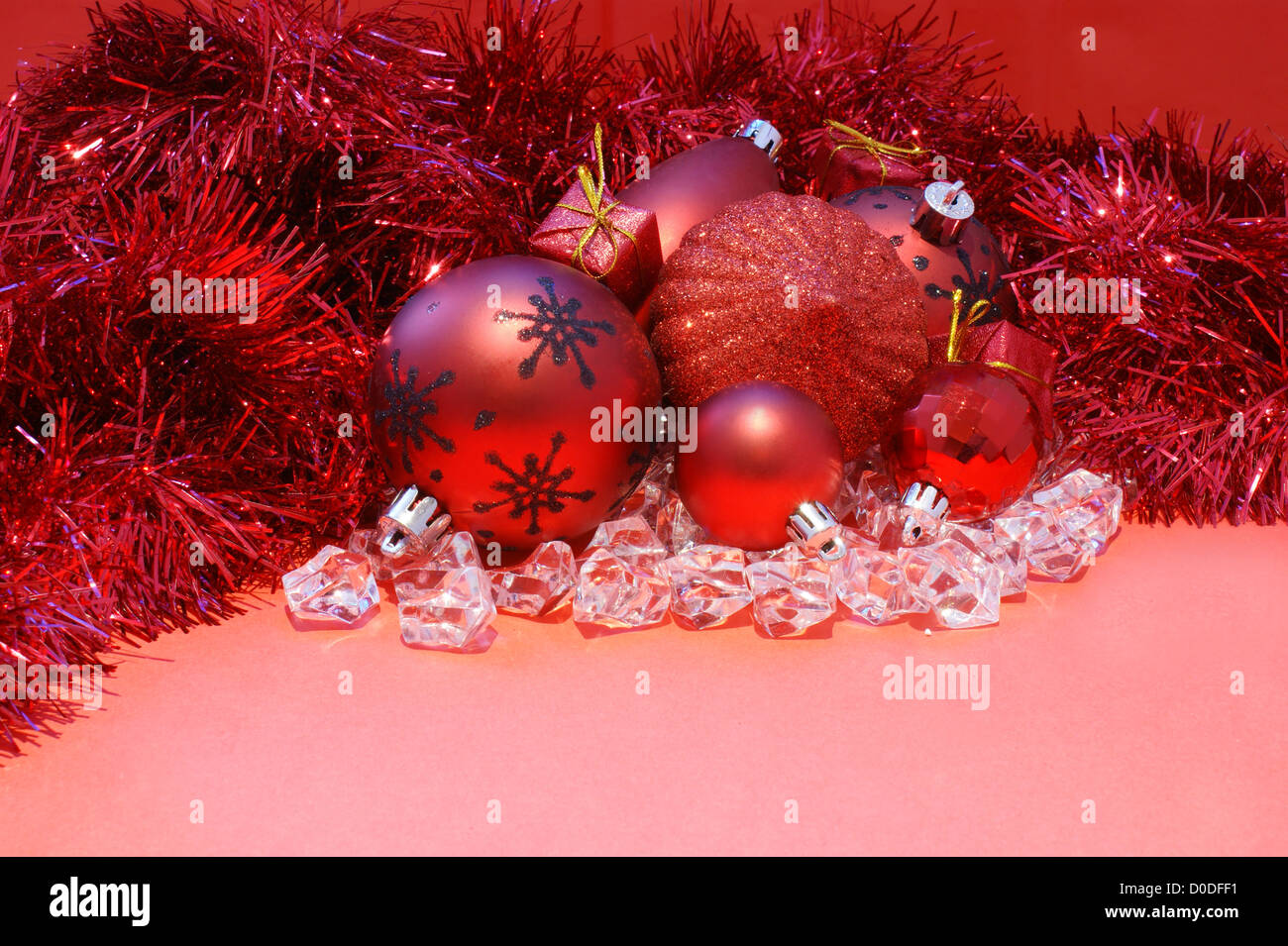 Christmas background with decorations, tinsel and gifts - Stock Image