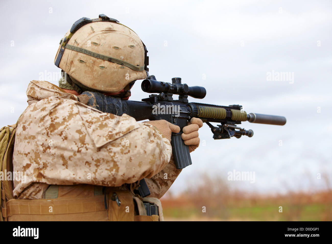 United States Marine aims a designated marksman rifle, Marjah, Afghanistan - Stock Image