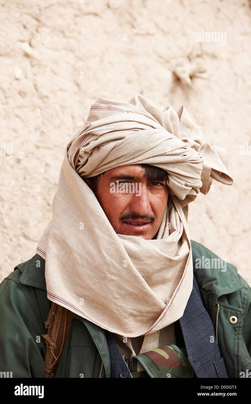 Member of an Afghan militia, wearing turban, Helmand Province of Afghanistan - Stock Image
