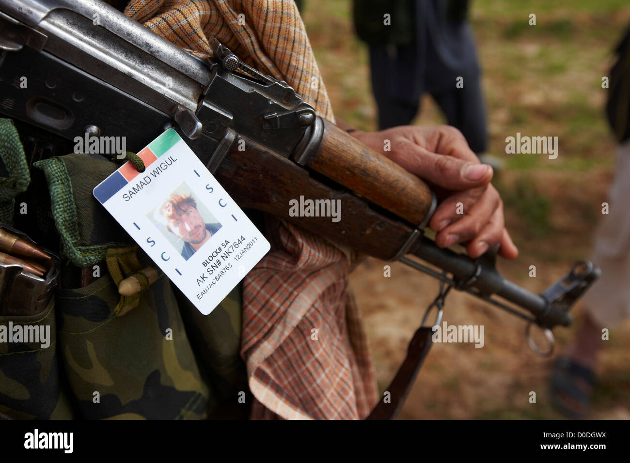 Detail of an Afghan Militia member's AK-47 assault rifle during a combat operation in Afghanistan's Helmand - Stock Image