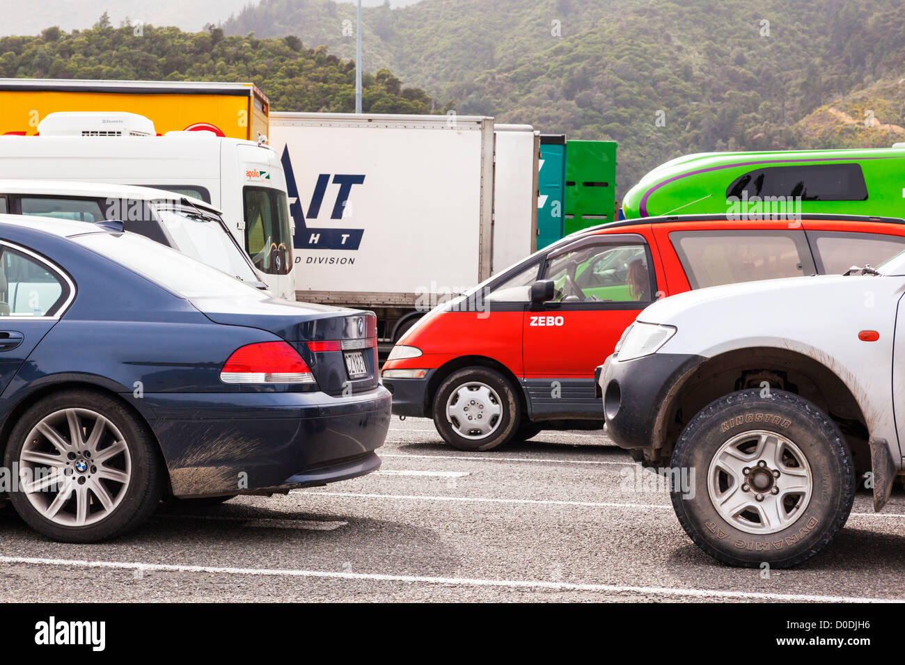 Cars, trucks and motorhomes lined up at Picton docks, waiting for the Wellington ferry. - Stock Image