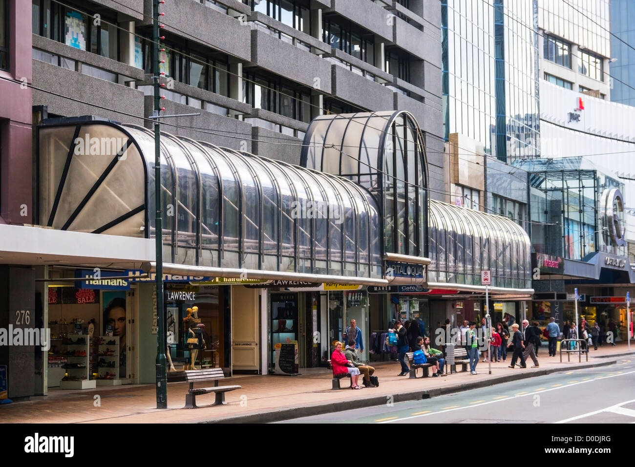 Lambton Quay, the main shopping street in Wellington, New Zealand, people sitting on benches, waiting at bus stop. - Stock Image