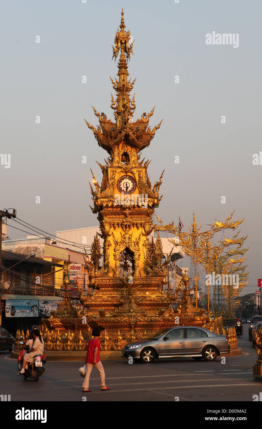 Golden clock tower in Chiang Rai, Thailand, Asia - Stock Image