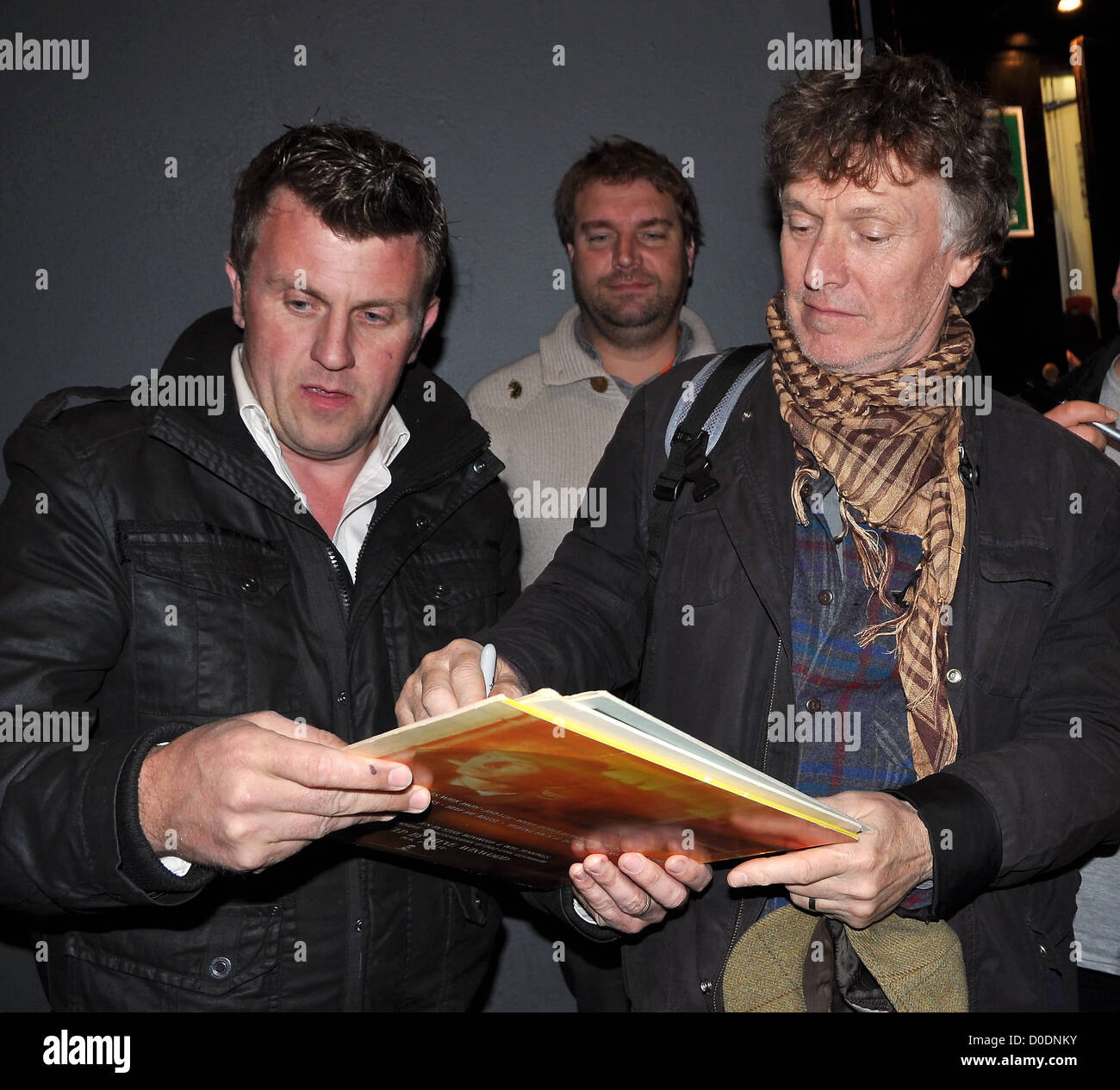 Steve Winwood is mobbed by autograph hunters after performing at The Olympia Theatre. Dublin, Ireland - Stock Image