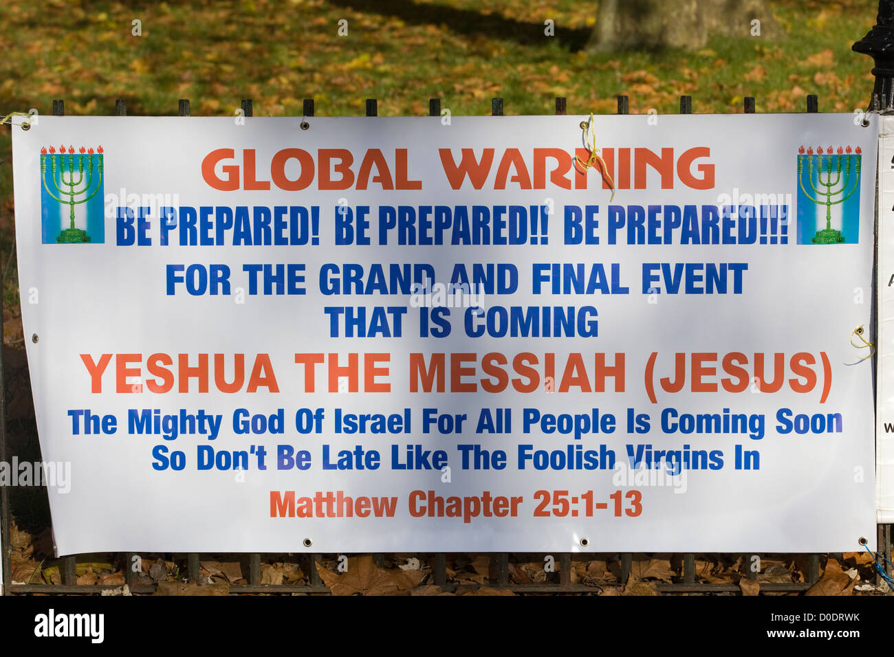 Global Warning Poster 'The Mighty God of Israel`' at Speakers corner Hyde Park London - Stock Image