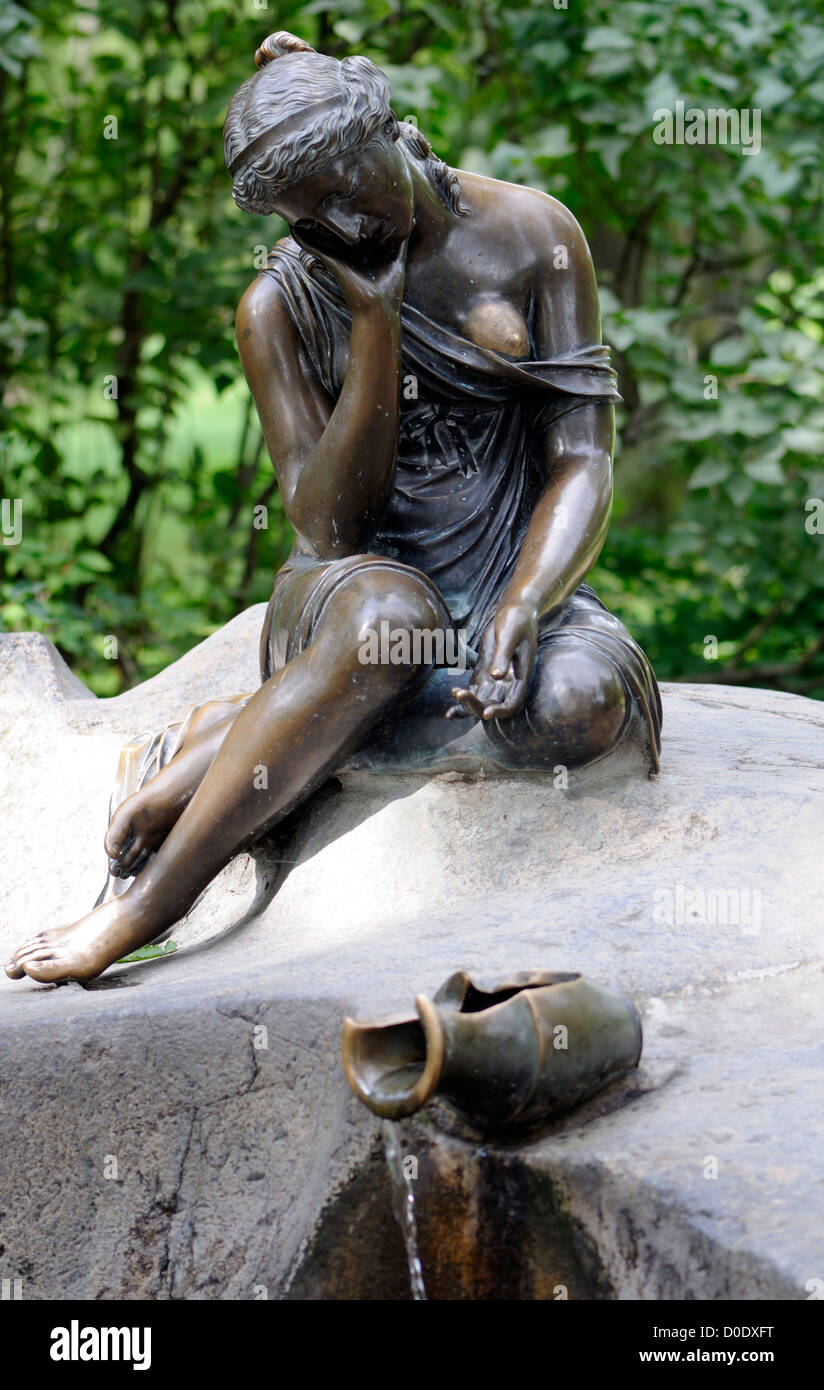 Fountain in the form of a bronze statue of a girl with a broken pitcher, known as a milkmaid. Tzarskoje Selo Palace - Stock Image