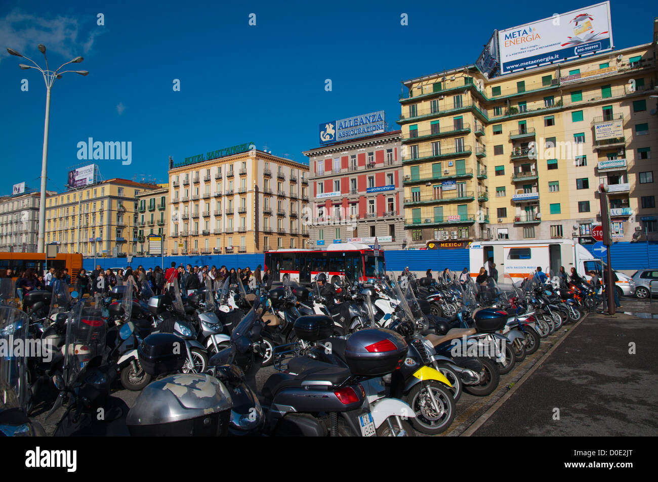 Scooters parked in front of central railway station Piazza Garibaldi square central Naples city  Italy - Stock Image