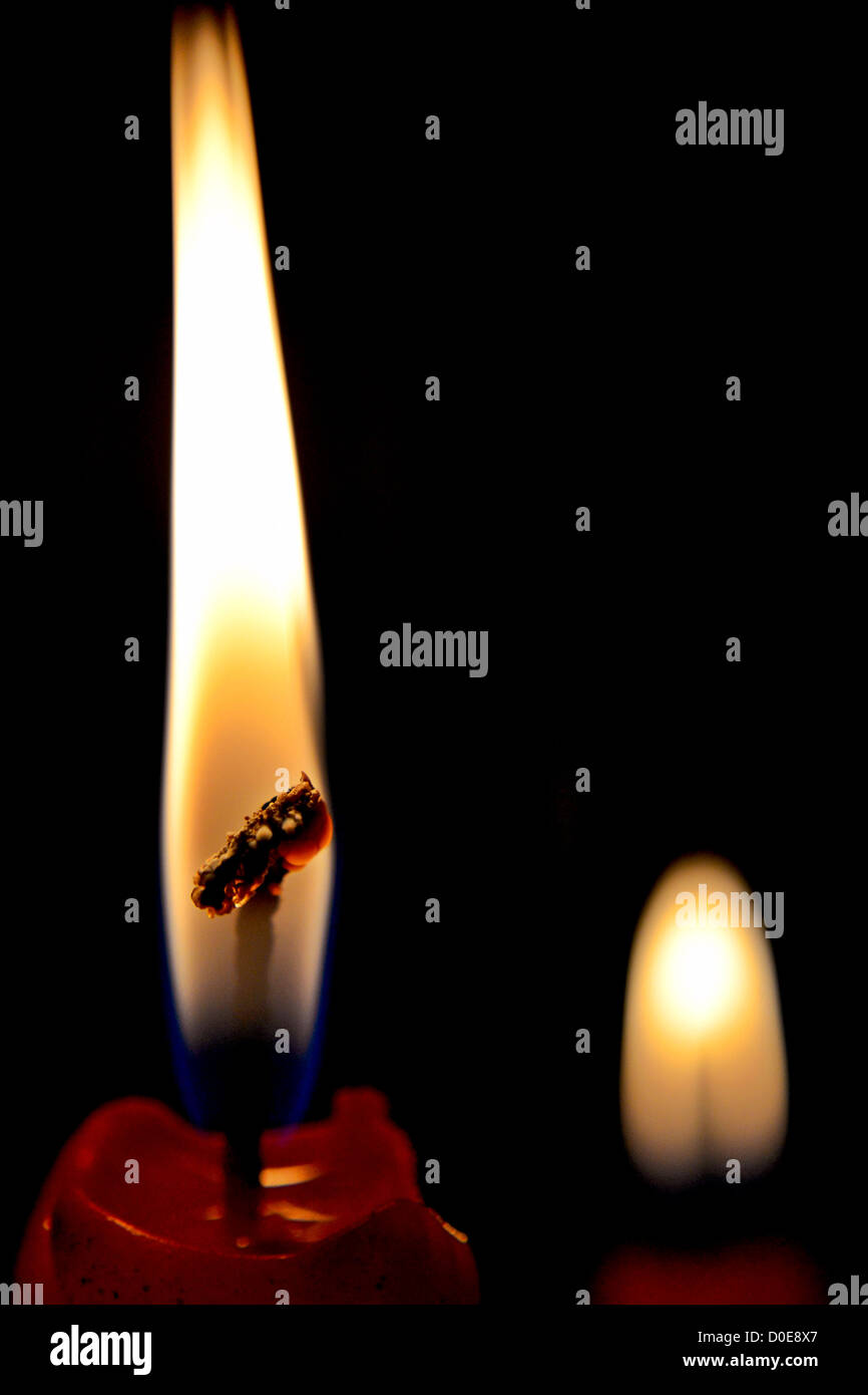 A candlelight in darkness - Stock Image