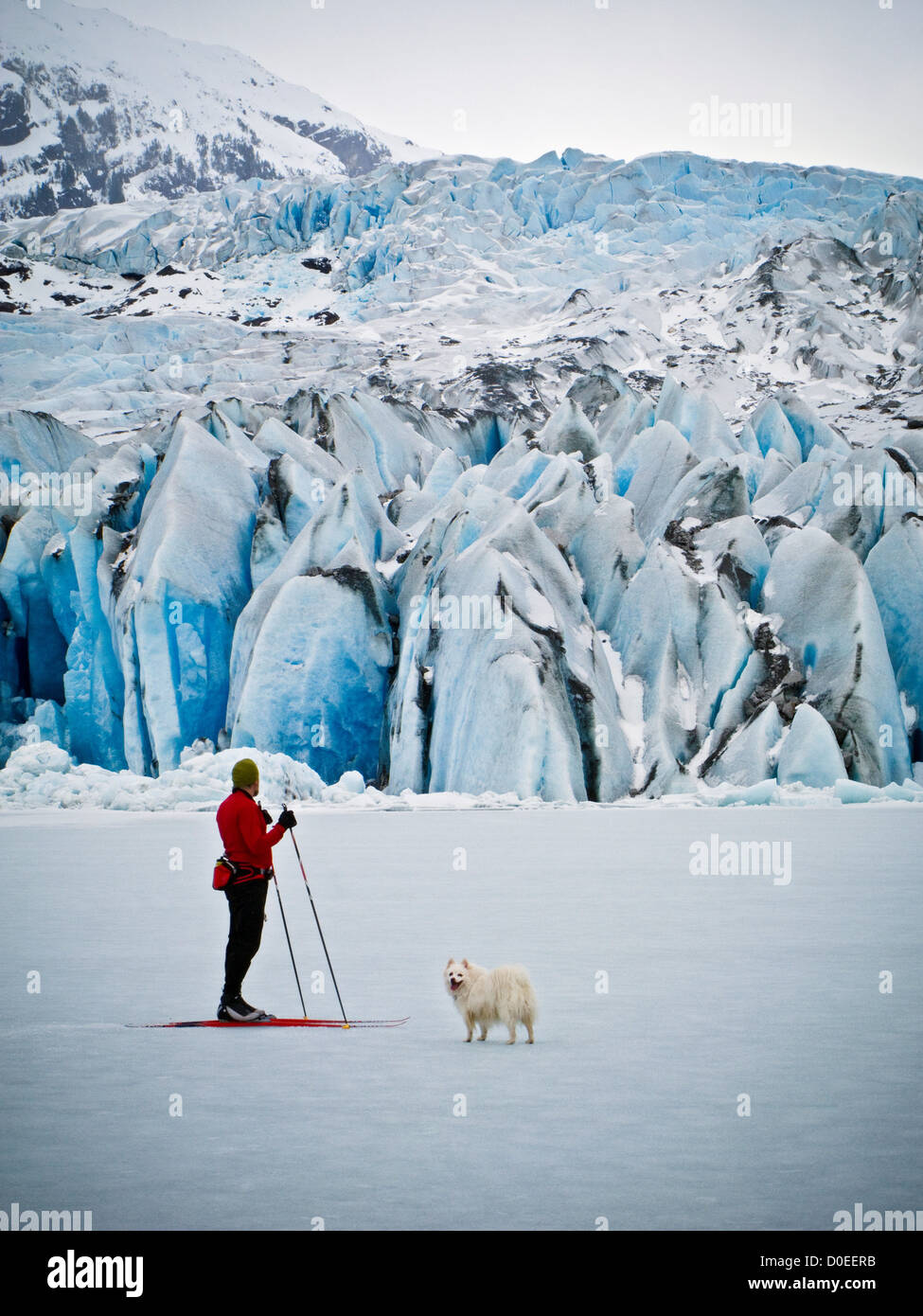 Mendenhall Lake in Juneau Alaska freezes during winter months. You can then ski or skate up face Mendenhall Glacier. - Stock Image