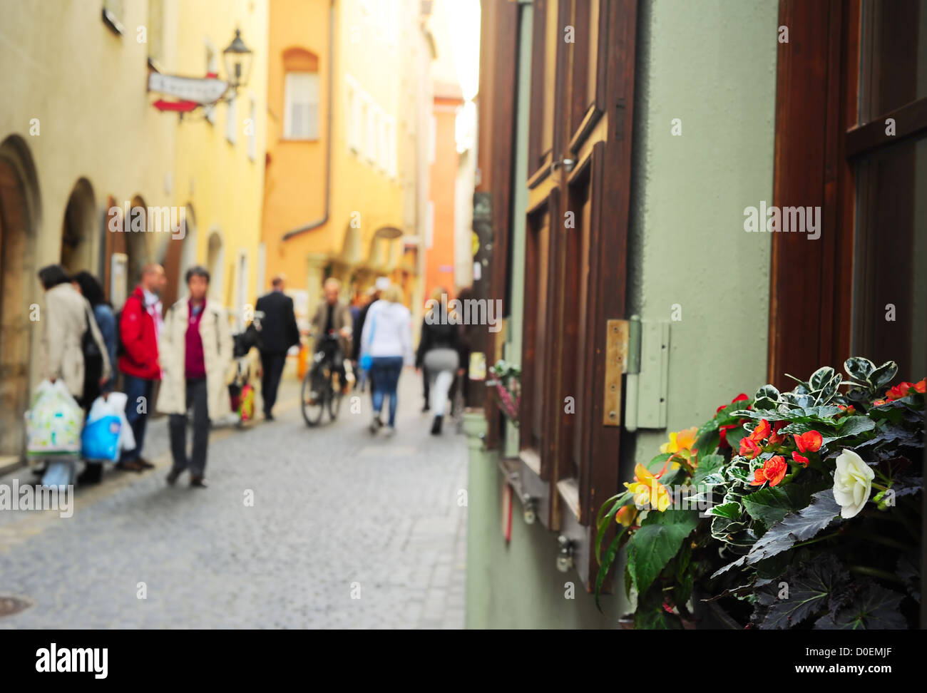 Flowers on the windowsill in Regensburg old town, Germany - Stock Image