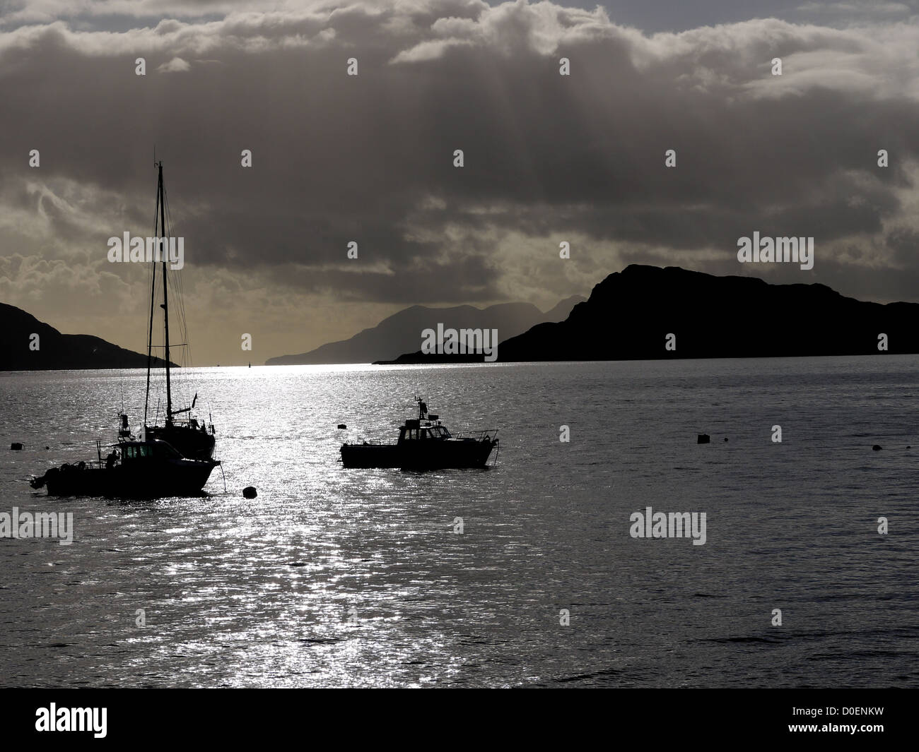 Small boats moored up in sea Loch Nevis in Inverie Bay on the West Coast of Scotland UK - Stock Image