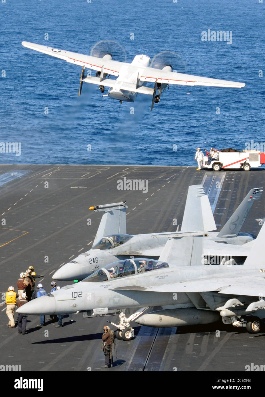 A C-2A Greyhound launches from the flight deck of the aircraft carrier USS Nimitz November 11, 2012 in the Pacific - Stock Image