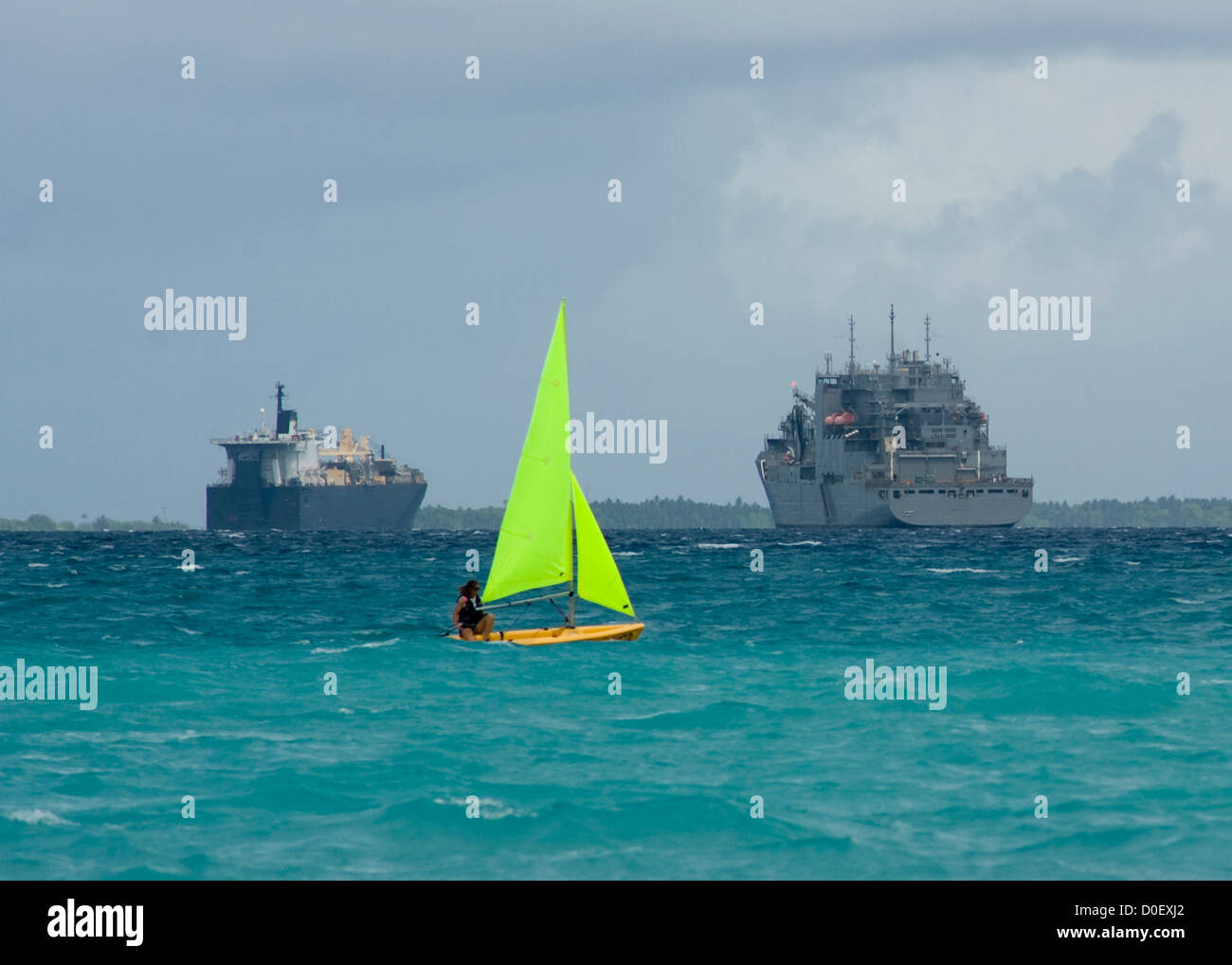 A US Sailor sails on a Pico sailboat November 4, 2012 In Diego Garcia, British Indian Ocean Territory. - Stock Image