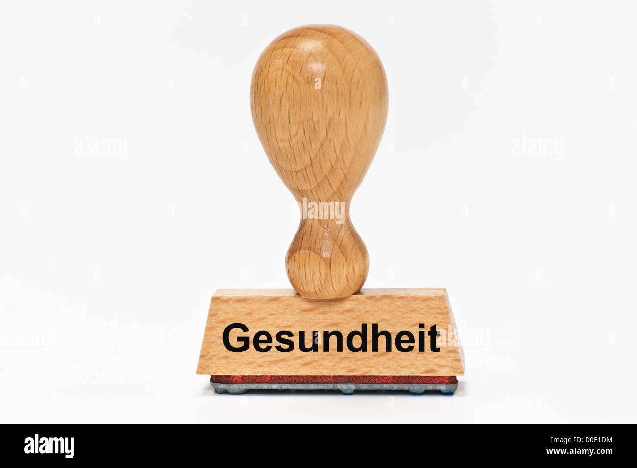 One Stamp with the German inscription Gesundheit (Health) upright, background white Stock Photo