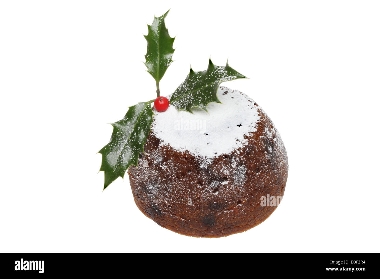 Christmas pudding dusted with icing sugar and decorated with holly isolated against white - Stock Image
