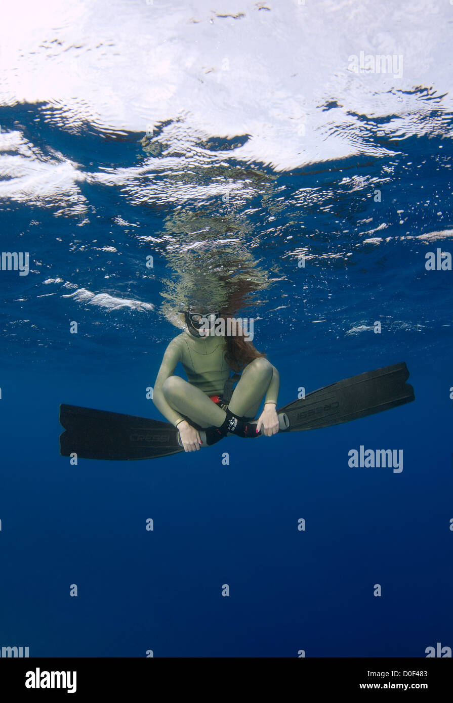 Female freediver  under water Stock Photo
