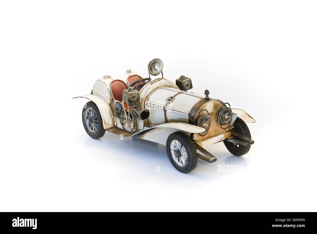 white oldtimer model at front - Stock Image