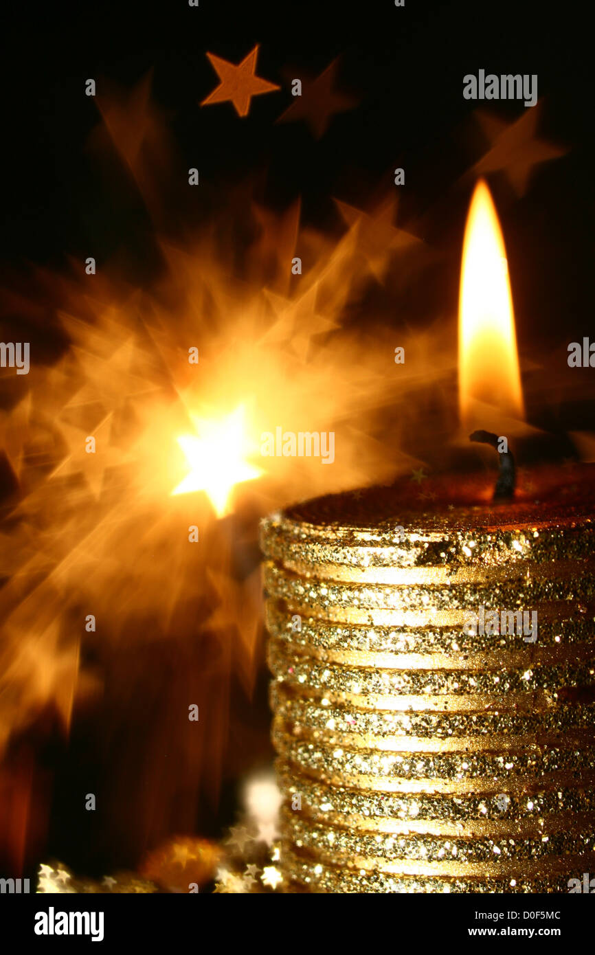 magic candle holiday background stars in dark Stock Photo