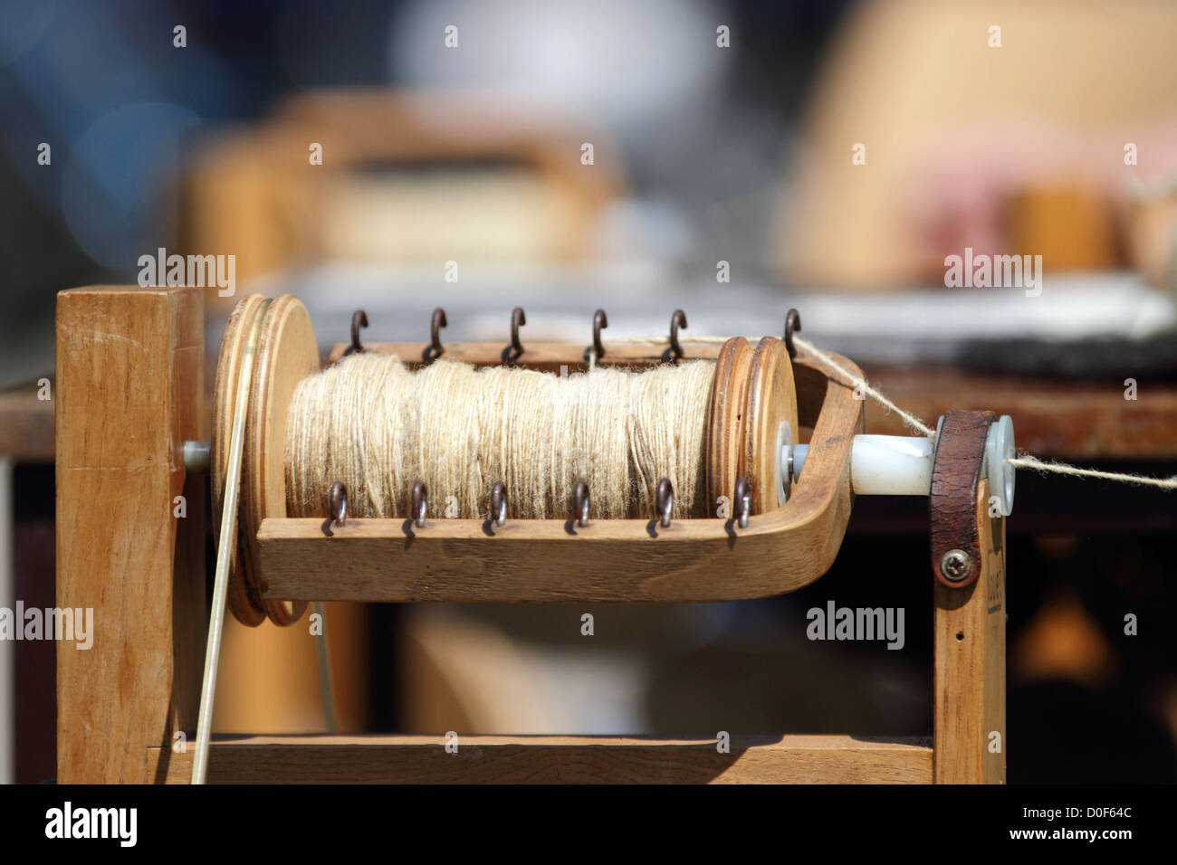 Close up of wool being spun on a spinning wheel. Stock Photo