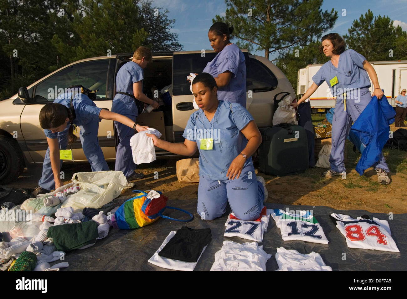 Nursing students faculty Emory University School Nursing in Atlanta Georgia volunteering give checkups in school - Stock Image